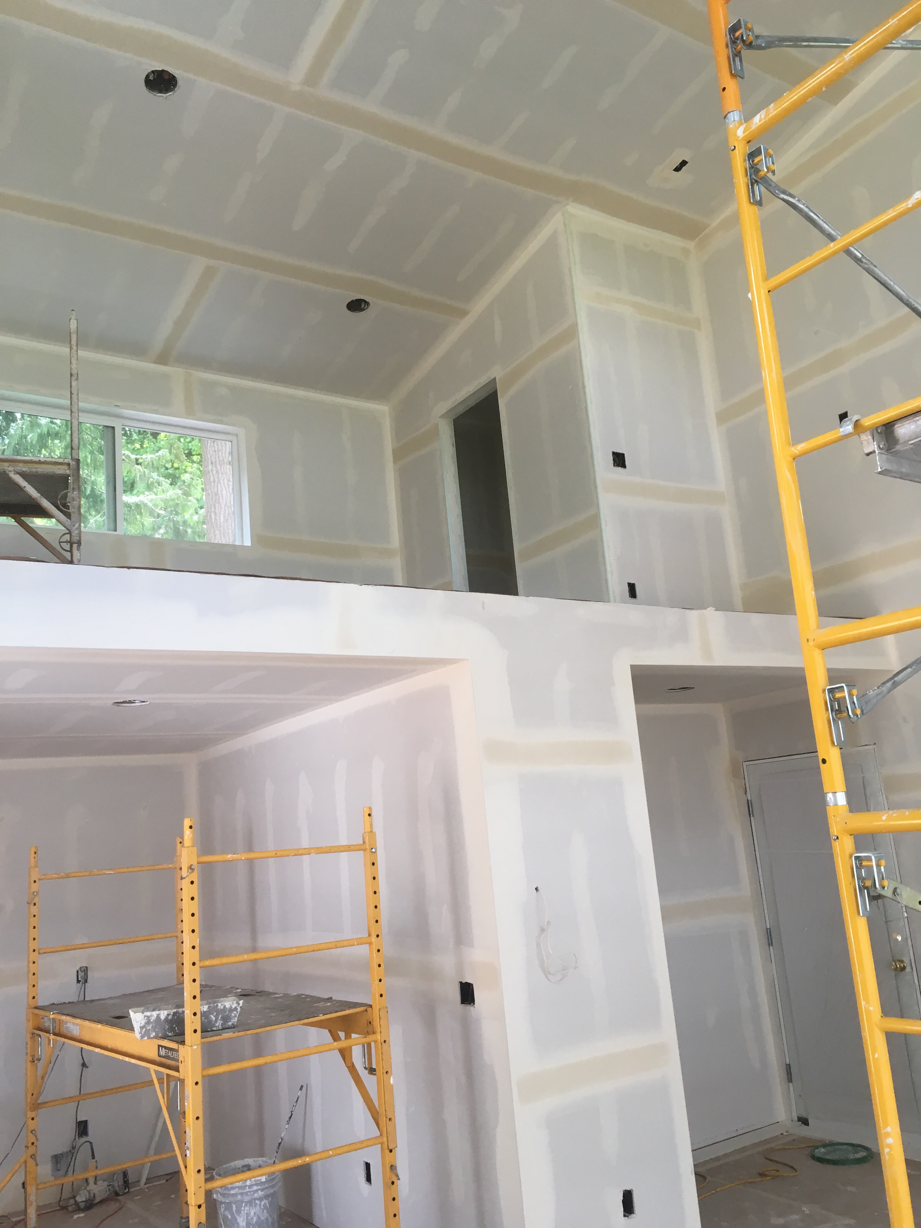 Lake cabin interior with coated drywall