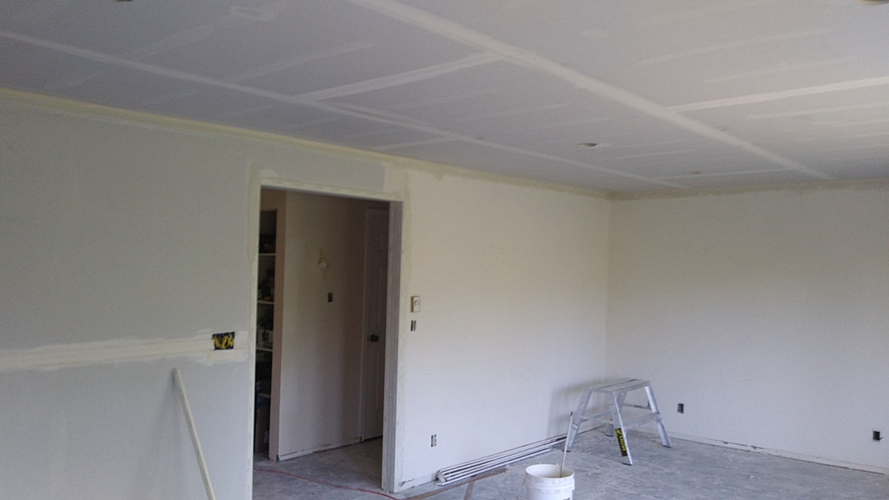 New ceiling and walls first coating on the drywall installation